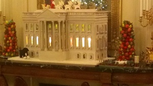 The gingerbread version of the White House is under siege from an oversized depiction of Bo, the First Dog.