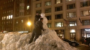 After two full days of relentless snow, the weather finally cleared in Boston Friday night. Here, two young men take advantage of a snowbank outside the Hynes Convention Center by building themselves a female companion. (They probably could have won over half of the female attendees at the conference with a well-crafted poem.)