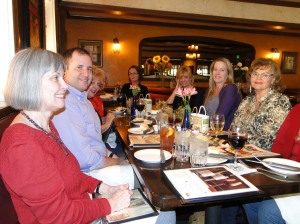 Cynthia's writers' group gathers for a holiday dinner.