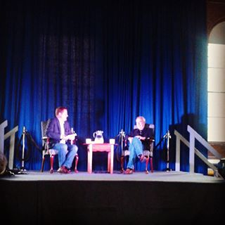 Tom Greene interviews Richard Russo in Alumni Hall at the Vermont College of Fine Arts (source: VCFA)